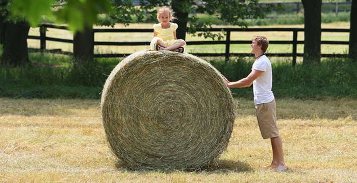 Haystack with child on it